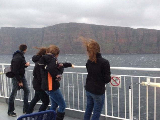 Visitors enjoying the bracing winds off Orkney