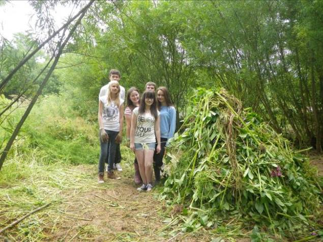 Inspira summer youth programme clearing Himalayan balsam along the River Caldew at Cummersdale Holmes, Carlisle
