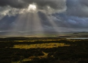 Sun rays over the Orton Valley by Sunbiggin Tarn, Little Asby Circle in the foreground. C.Paxton photo.