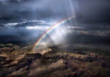 Spectacular rainbow over Namibia's formidable desert landscape. Paul van Schalkwyk photo and copyright