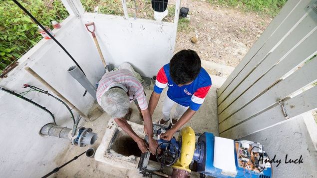 Maintenance of community micro-hydro electricity generation project, Sabah, Borneo. Andy Luck photo and copyright.