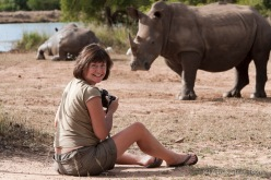 Ann Toon photographing white rhino at Hlane game reserve, Swaziland