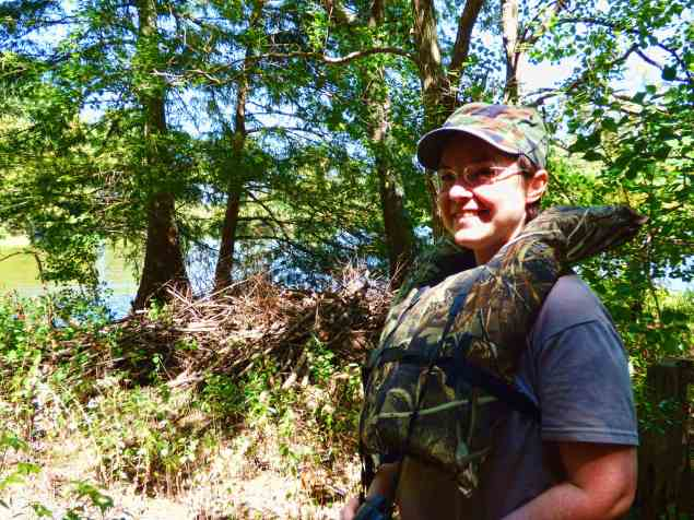 Kimmie beside occupied Beaver's lodge on Lake D'Arbonne.