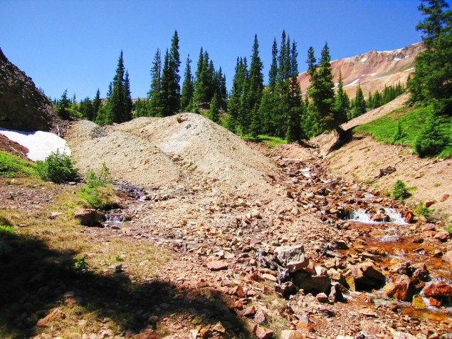 The main waste rock pile at Vernon Mine in July 2014 (before removal ). Uncompahgre Watershed Partnership (UWP)  photo  and copyright .