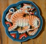 Bhutanese wooden carving of a tiger. C.Paxton photo and copyright.