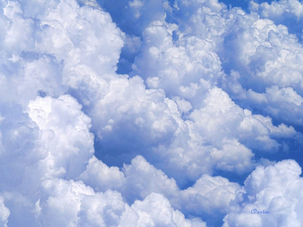 fluffy white clouds with blueish haze