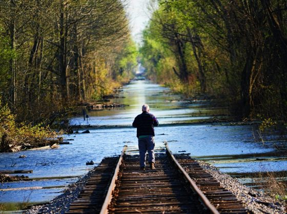 2016 Spring Flood in North Louisiana. A man looking down a flooded railway line.