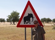 Andy Luck beside Elephant awareness sign in Namibia.