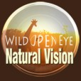 The words WILD OPEN EYE Natural Vision in white text over an African safar scene with a giraffe framed in a 'lens'