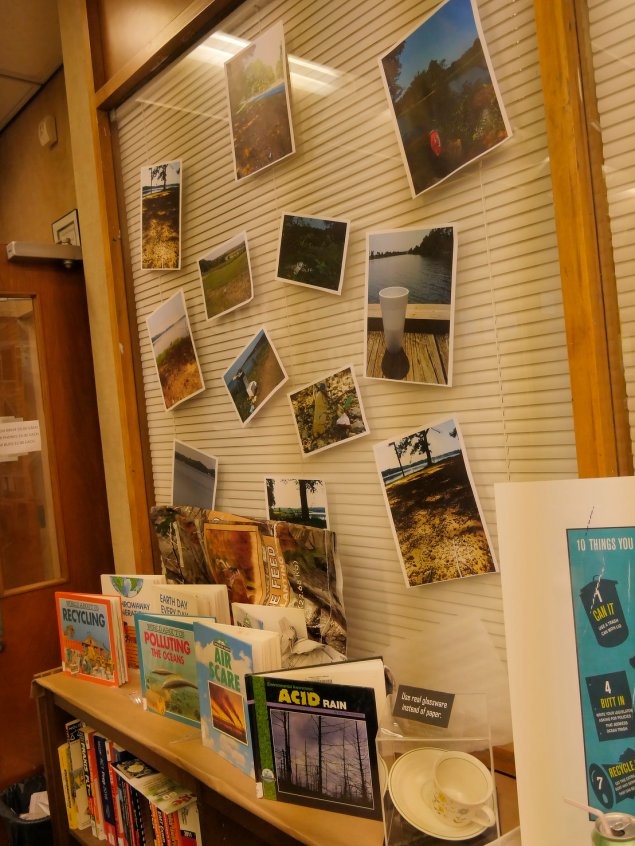 Some images of trash as found in familiar places in Union Parish above books on pollution.