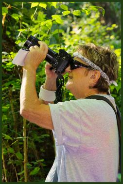 Louisiana Master Naturalists Northeast chapter founder and Chair, Dr. Bette Kauffmann photographing wildlife with telephoto and reflector. C. Paxton image and copyright.