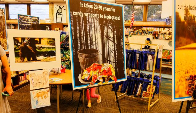 Litter and bears. Each exhibit shows a poster with the habitat and an exemplary species that is adversely affected by a particular type of trash. In this case, plastic food wrappers, feared to last 20-30 years and known to have impacted bears.