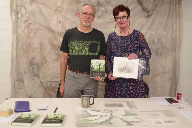 Author Kelby Ouchley with artist Emily Caldwell at the exhibition of her delightfully whimsical artwork in downtown Monroe.