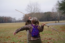 Kimmie recoiling the Atlatl in preparartion to launch!